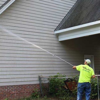 man-power-washing-a-house