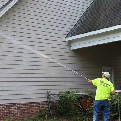 man-power-washing-a-house